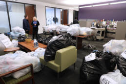 Photo of dozens of bags full of blankets for donation