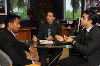Businessman in a suit and tie using interpretive services at a meeting
