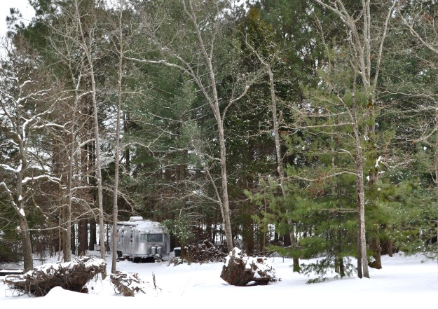 Airstream in the snowy woods