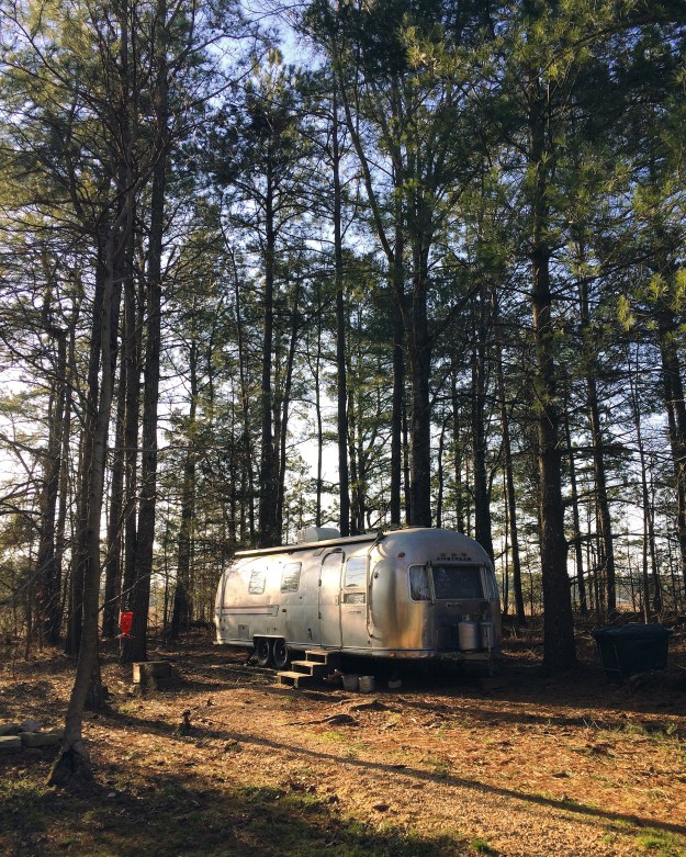An Airstream in the Woods