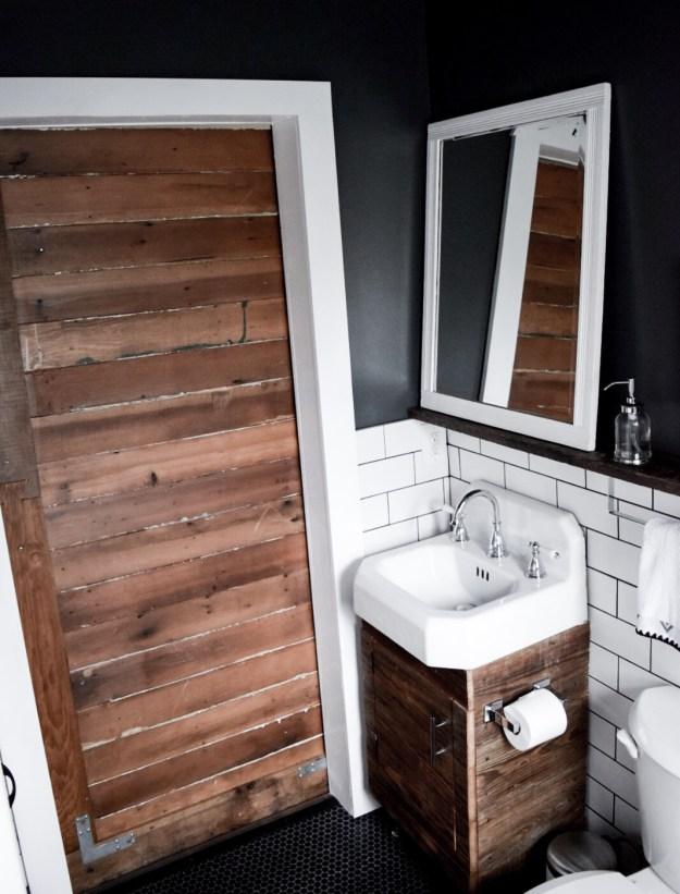 Sliding Barn door closed in bathroom.