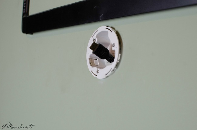 Once the holes are drilled and wires are fed through, attach the bracket