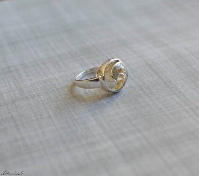 The sterling silver wave ring can feature sand from anywhere in the world, custom made for you