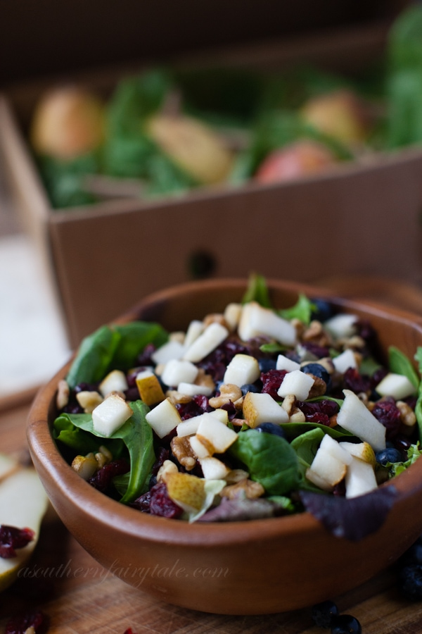 pear and berry dark green leafy salad