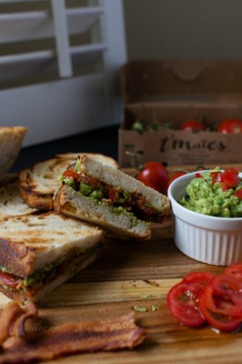 toasted bacon and guacamole sandwich with sliced del campo t'mates