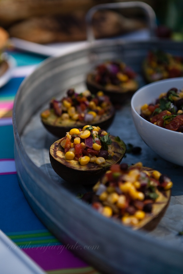 Grilled avocados with black bean and corn pico