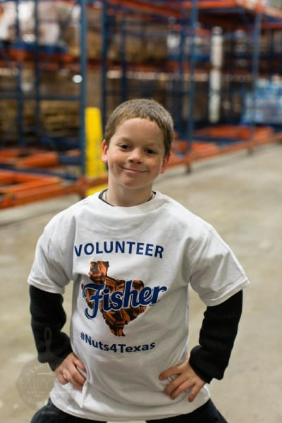 Monkey posing in his Fisher Nuts 4 Texas Volunteer Shirt