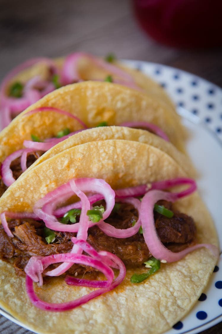 brisket tacos with pickled red onions and jalapenos