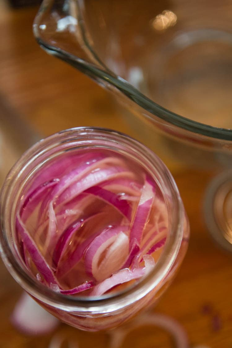 red onions in a mason jar for pickling