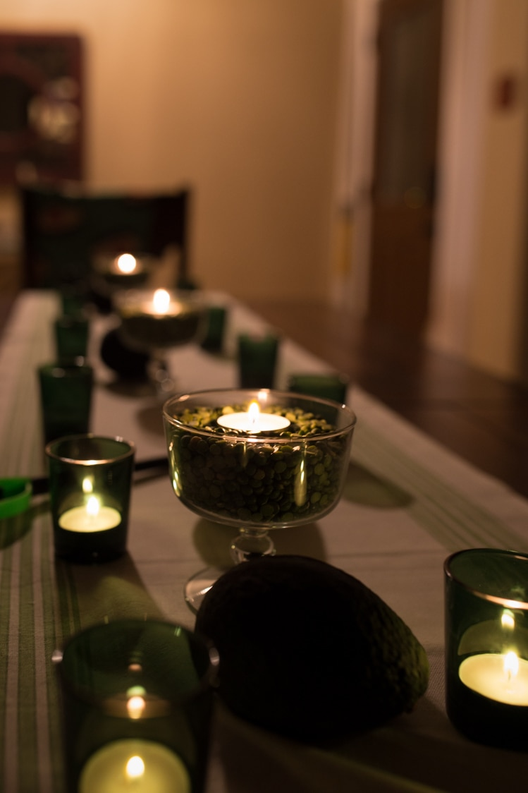 split peas, candles, and avocados for easy dinner en green table decorations