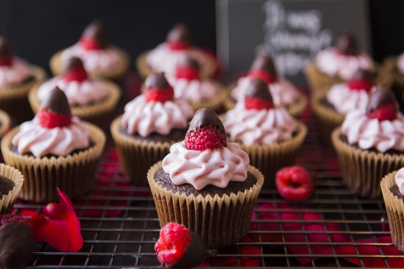 chocolate dipped raspberry cupcakes with raspberry frosting