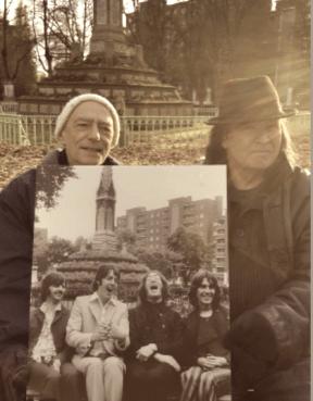 two men sitting in St Pancras Old Shurhyard.