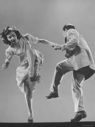 Couple dancing Lindy Hop.