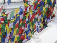 The colourful prayer flags represent the elements: Blue symbolises sky/space Red symbolises fire Green symbolises water Yellow symbolises earth White symbolises air/wind