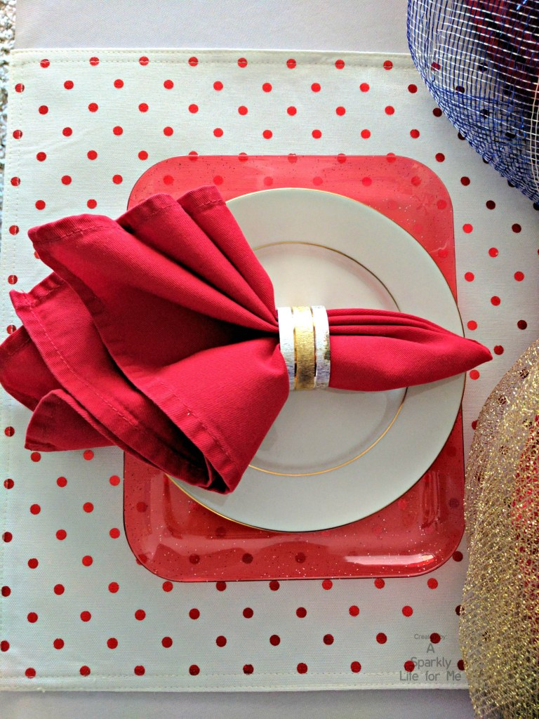 Red and white polka dot place mat with red and white plate layers for patriotic table decor