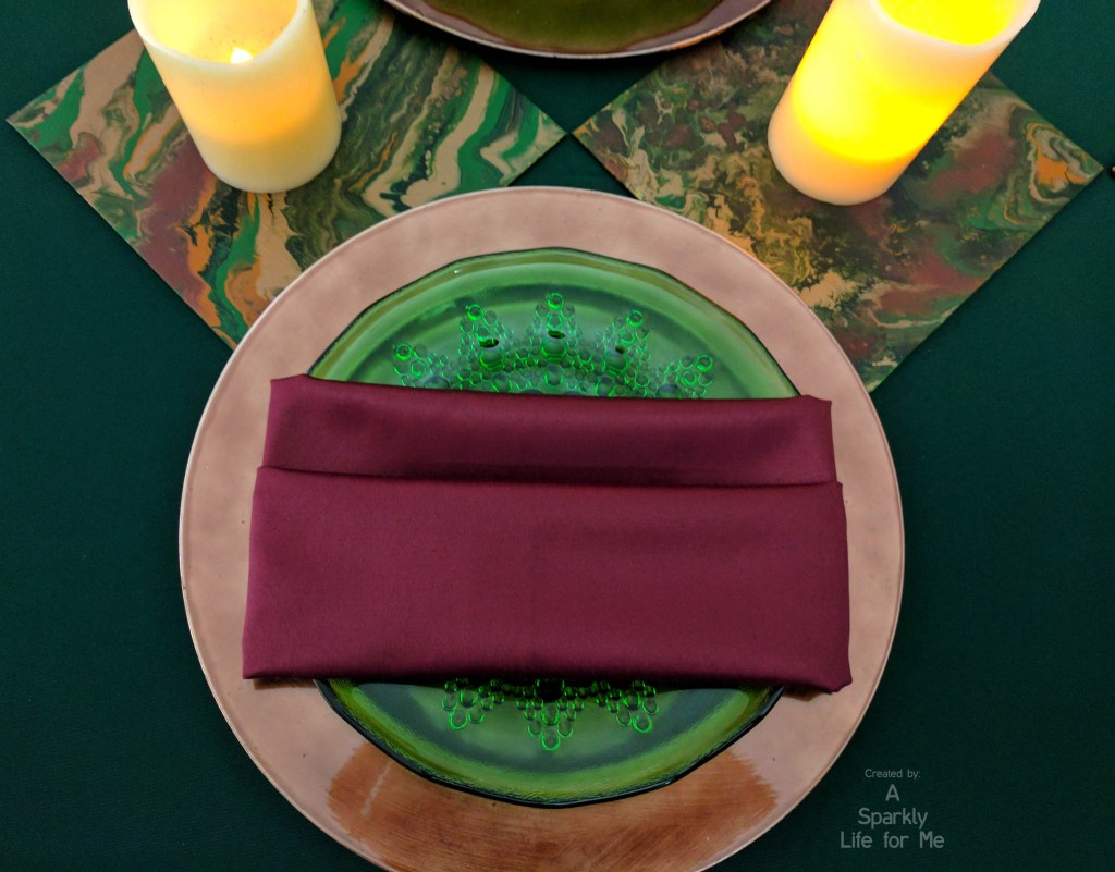 rose gold, green, and burgandy place setting for a modern midsummer marble tablescape With DIY fluid acrylic table runner accents