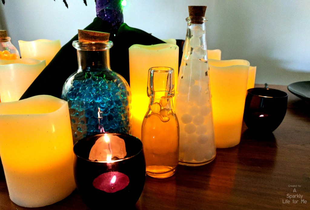 DIY Glowing Potion Tree base close up of LED candles and potions - by A Sparkly Life for Me