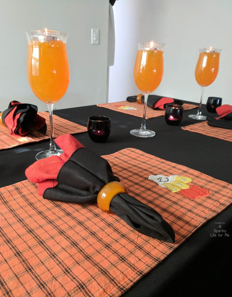 Easy tablescape for halloween using thrift store decor and orange gel beads by A Sparkly Life for Me