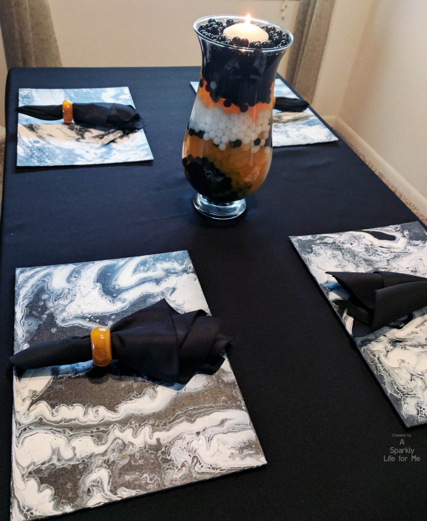 Fluid acrylic place mats and halloween table decor by A Sparkly Life for Me
