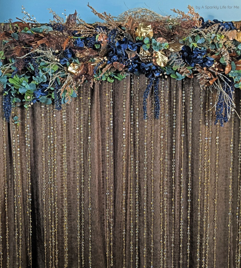 DIY Easy Backdrop with Navy and Metallic Garland and Champagne Beaded Curtains