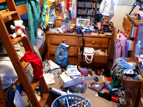 Kids room organization is a key competency for both children and parents - this photo shows what a messy kids bedroom looks like.