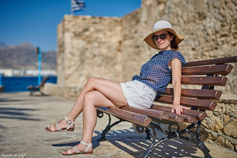 blue shirt, white shorts in Ierapetra, Crete