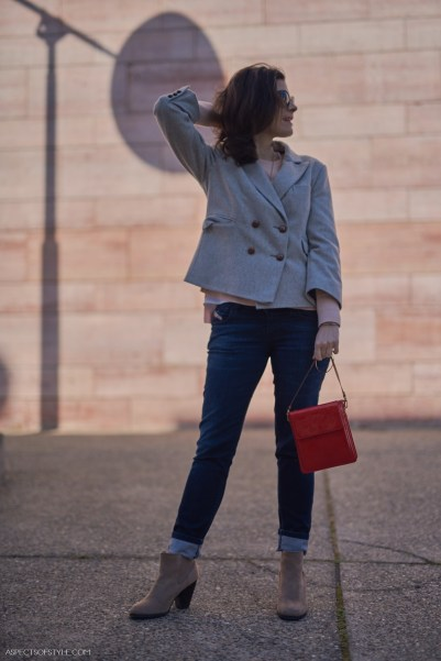 Louis Vuitton red clutch, grey jacket and Call it Spring beige boots