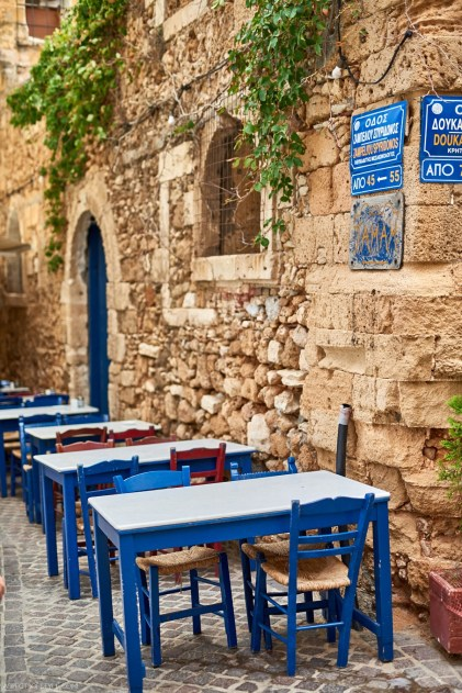 blue table and chairs in Chania old town