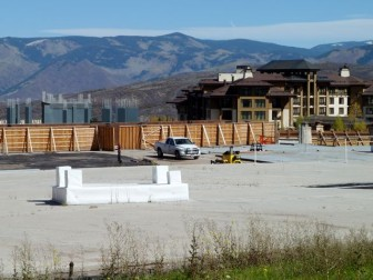 The skeleton of The Little Nell Snowmass hotel is to the left, in the back of the concrete slab. The Viceroy hotel is to the right.