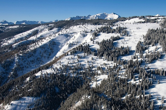 The east side of Richmond Ridge, where Aspen Mountain Powder Tours has the exclusive right to used motorized vehicles to make laps. The run called McFarlane's is the big gulch in the middle-left of the photo. Trails called Wine Tree and WOFTR (Watch Out For The Road) are further out the ridge.