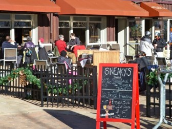 The deck of Sneaky's Tavern in Base Village on a sunny Friday afternoon, Dec. 16.