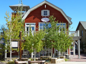 """Meant to evoke the ranching heritage of the Brush Creek valley, the red """"Sweet Life"""" building sits at the center of Base Village."""
