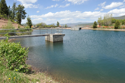 The 10.3 acre-foot Thomas Reservoir. The new outtake structure is in the rear of the photo, on the north side of the reservoir.