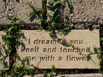 A fan's message carved in a brick under the statue of John Denver at Windstar.
