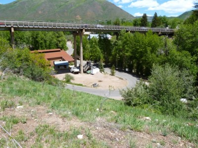 The pipeline designed to serve as a penstock and an emergency drain line runs underground down this hillside and stops shy of Power Plant Road and Castle Creek. The city now plans to install an outfall, or tailrace, to be able to use the pipeline for emergencies or for routine drainage of water from Thomas Reservoir.