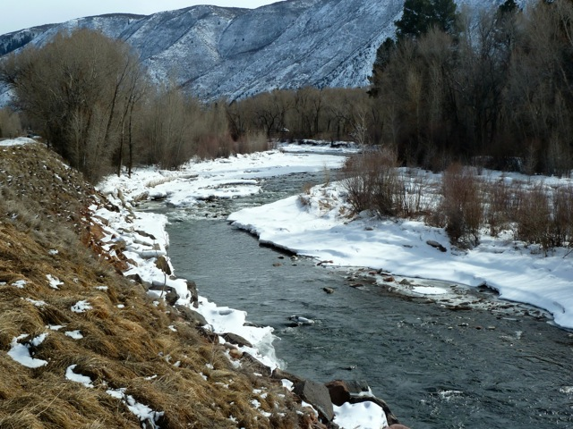 Looking upstream on Feb. 24, 2013, at the location on the Roaring Fork River in Basalt of a proposed kayak park. The first of two rock and concrete structures would be placed in the river where the riffle is at the top of the straight section. A staircase would be built down the hillside and parallel parking would be added along Two Rivers Road, just across from the entrance to the Elk Run neighborhood. Pitkin County's efforts to obtain water rights for the kayak park are being met with opposition.
