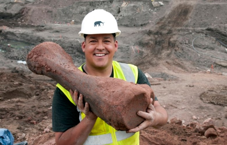 Paul Vallejos, a volunteer at the excavation at Ziegler Reservoir, holds a mastodon's tibia he found in 2011.