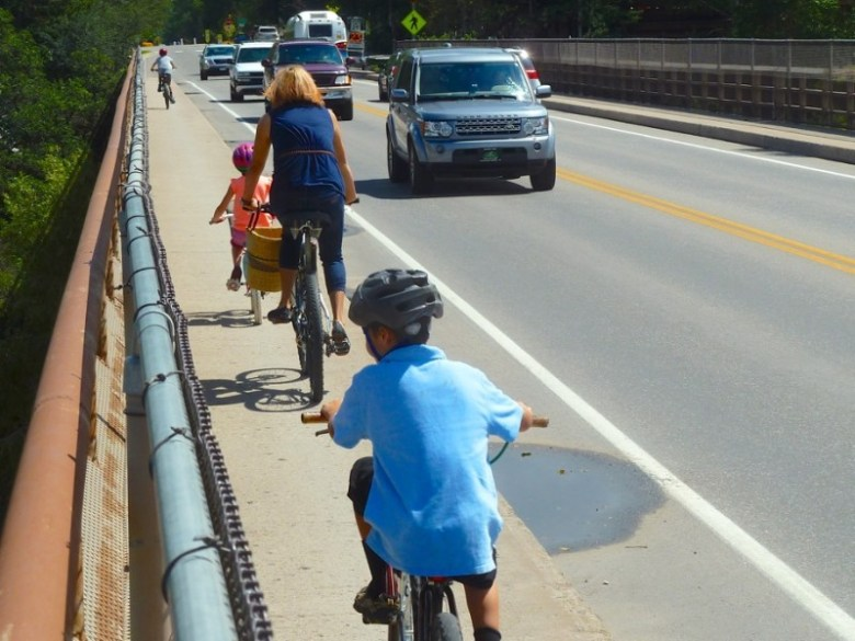 Riders heading toward Aspen on the north side of the Castle Creek bridge, which allows little room for error.
