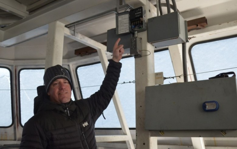 This timer, indicated by Mountain Operations Director Brian Suhadolc, reduces the energy that Park City Mountain Resort uses to heat its lift terminals.