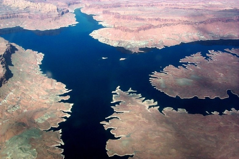 An aerial view of a relatively full Lake Powell.