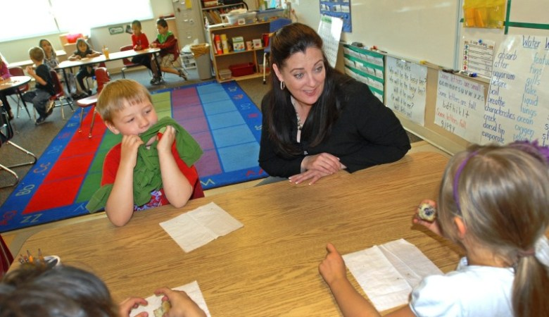 Garfield School District Re-2 Superintendent Susan Birdsey chats with kindergarten students at Cactus Valley Elementary School in Silt.