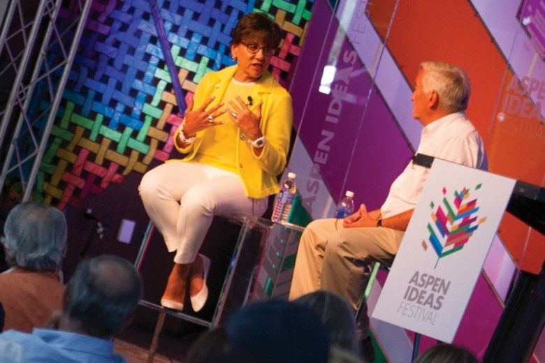 Penny Pritzker, left, with Aspen Institute CEO Walter Isaacson at the 2014 Aspen Ideas Festival.