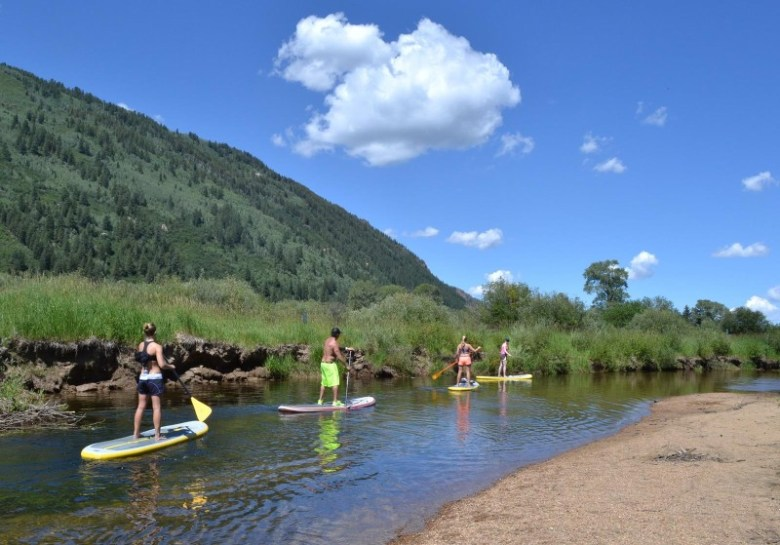 Stand up paddleboarders drift with the slow-moving Roaring Fork River at North Star Nature Preserve. The boom in SUPs has made North Star a popular recreation area.