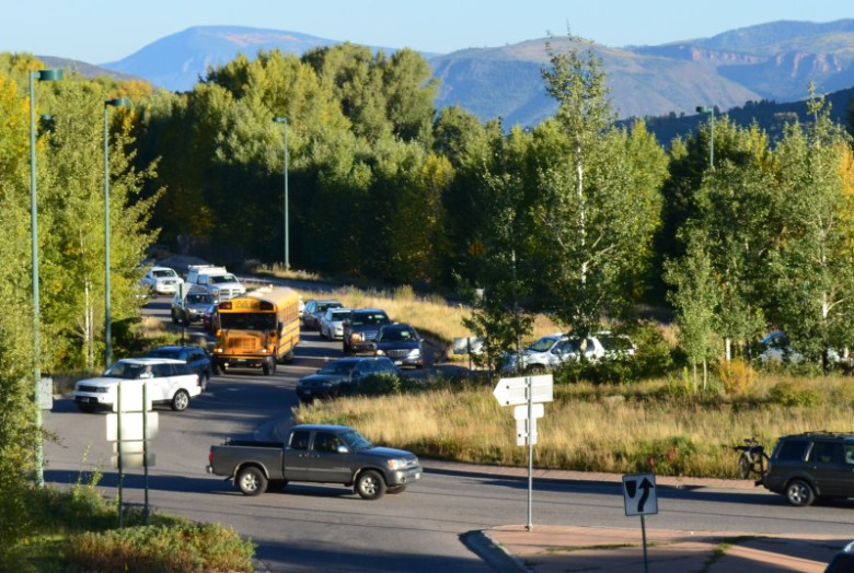 Temporarily blocked by traffic in the Maroon Creek roundabout, a school bus stops en route to the Aspen schools on a recent morning.