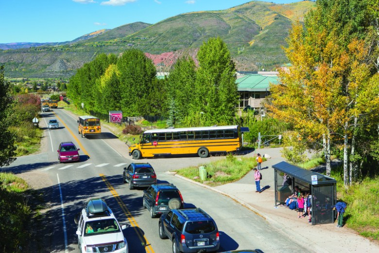 Leaving the schools on a recent afternoon, a school bus competes for space on Maroon Creek Road. Aspen School District officials are trying to reduce school-related traffic by coaxing families to use the bus.