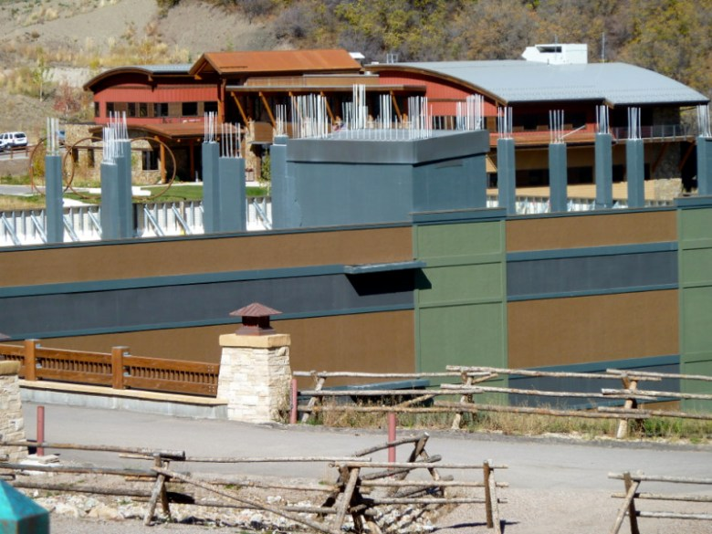 There is tension in Snowmass Village town hall, background, over completing the Base Village project, foreground.