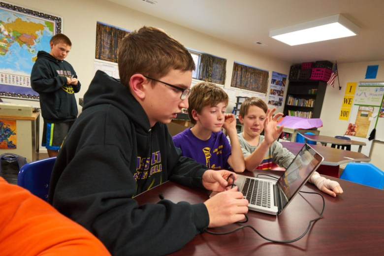 Members of the Longhorn Bots, a Basalt Middle School robotics team, use computers to program their Lego machines.