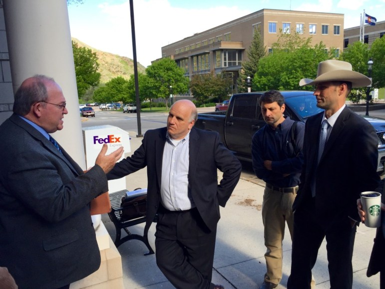 From left, Russ George, a CWCB board member, Andrew Gorgey, then Garfield County manager, Peter Fleming, general counsel for the Colorado River District, and James Eklund, director of the CWCB, talking about the potential for new transmountain diversions outside of the Garfield County building in Glenwood Springs in 2015.