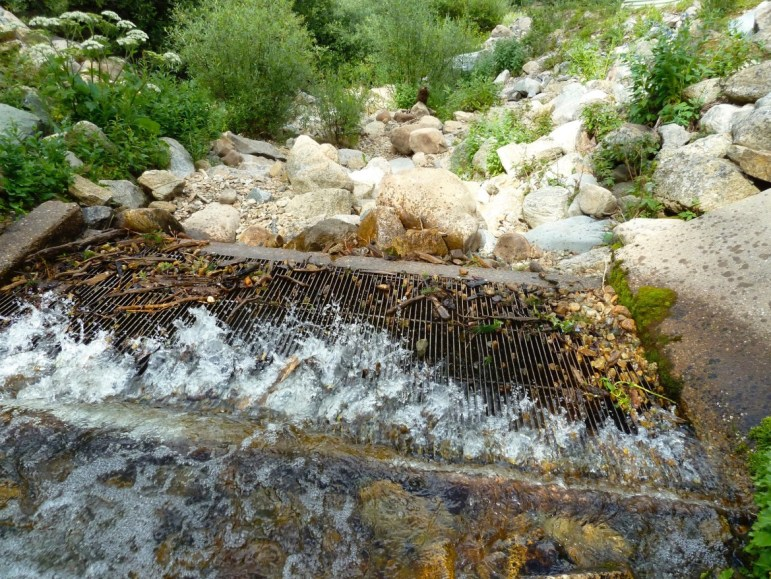 The grate in place on Sawyer Creek, a headwaters stream in the upper Fryingpan River basin, that captures water and sends it under the Continental Divide through the Fry-Ark project. There are several streams in the upper Fryingpan basin that could still be diverted via Fry-Ark.