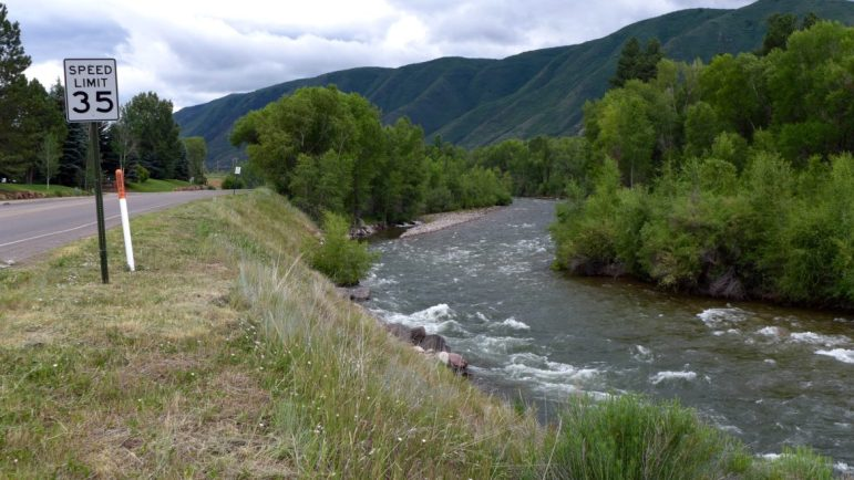 The steep riverbank on the Roaring Fork River where Pitkin County intends to build a whitewater kayak park. Looking upstream, early July, 2016.